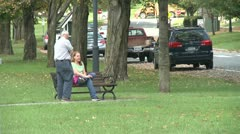 Conversing on a park bench (1 of 4) - stock footage