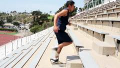 Young Asian Man Exercising Running up Stadium Steps Side View Stock Footage
