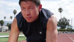 Young Asian Man at the Starting Line Stock Footage