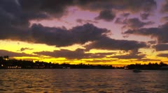 Fiery sunset over Fort Lauderdale seen from Yacht cruising New River - stock footage