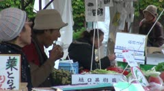 Japanese people eat breakfast with chopsticks at local morning market Stock Footage