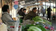 Market stalls at fruit and vegetable market in Japan Stock Footage