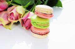 rose and macarons - stock photo