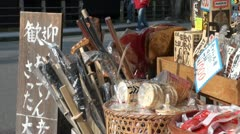 Souvenir shop in Japanese tourist village, items for sale, artefacts Stock Footage