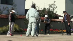 Stock Video Footage of Japanese elderly play a game of 'gateball', excercise, aged, senior citizens