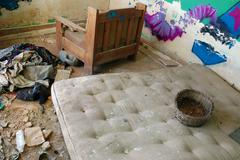 Dirty mattress in abandoned house Stock Photos