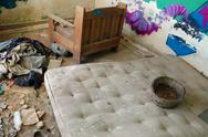 Stock Photo of dirty mattress in abandoned house