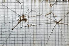 smashed wire glass squares background - stock photo