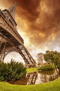 beautiful sunset colors of eiffel tower with its magnificence - paris - stock photo