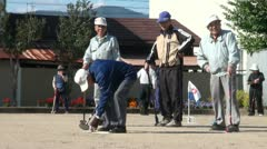 Old Japanese men are playing 'gateball', popular sport to stay fit in Japan Stock Footage