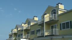 Yellow condominiums (1 of 1) Stock Footage