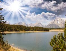 Stock Photo of wonderful landscape of grand teton lake and mountains - wyoming
