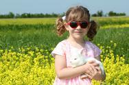 Little girl holding white dwarf bunny.JPG Stock Photos