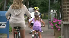 Riding bikes through town (3 of 7) - stock footage