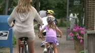 Stock Video Footage of Riding bikes through town (3 of 7)