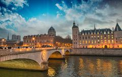 beautiful colors of napoleon bridge at dusk with seine river - paris - stock photo