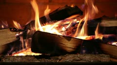 Close-up of a Real Wood Fire Burning in a Brick Fireplace Stock Footage