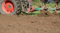 Closeup heavy agriculture machinery plough field soil Stock Footage
