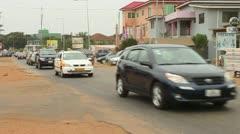 Slow Pan of Traffic, Street Scene in Accra, Ghana - stock footage