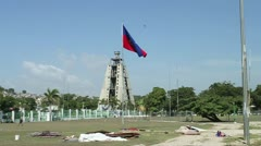 Pan of courtyard at Haitian presidential palace reveals flag, rubble Stock Footage