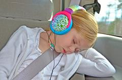 Little girl sleeping with headphones on Stock Photos