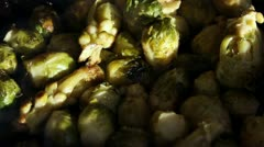 Chef stiring brussels sprouts on a frying-pan Stock Footage