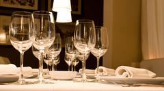 glasses of wine set at restaurant table - stock photo