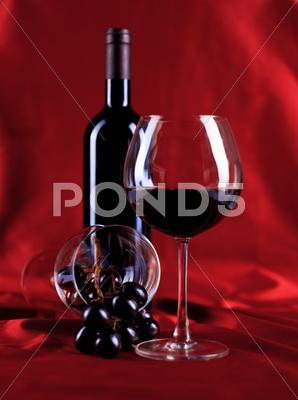 Stock photo of  wineglass and bottle