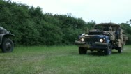 Stock Video Footage of Military vehicles passing in a field