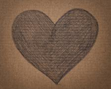 Heart shape in pencil on cardboard Stock Photos