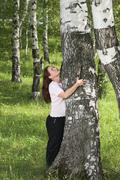 the woman and a birch - stock photo
