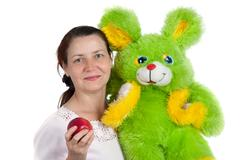 the woman with a soft toy - stock photo