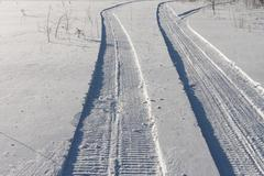 Traces of a snowmobile Stock Photos