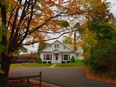 Fall colors and home. Stock Photos
