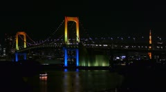 Tokyo Tower over Rainbow Bridge - with a Boat - HD Stock Footage