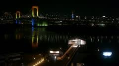 Tokyo Tower and Rainbow Bridge over Odaiba Pontoon - HD Stock Footage