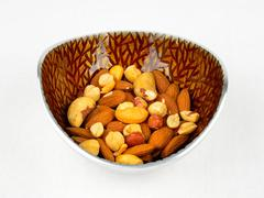 A bowl of mixed nuts Stock Photos