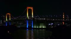 Tokyo Tower over Rainbow Bridge - Boat in Odaiba Bay - HD Stock Footage