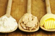Baking ingredients butter, yeast and meal Stock Photos