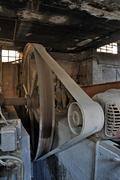 rusty belt driven machinery - stock photo