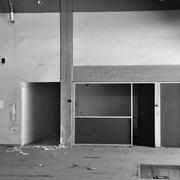Concrete wall and corridor in derelict factory Stock Photos
