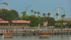 Seaworld Orlando Visitors Walking Over Bridge with Rollercoaster in Background Stock Footage