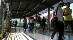 Pedestrians walking on elevated walkway Stock Footage