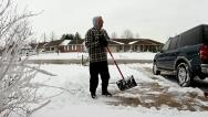 Stock Video Footage of Man shoveling snow and then stops with chest pain / heart attack