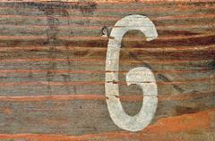 Number six wood background Stock Photos