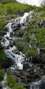 Mountain stream waterfall Stock Photos