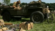 Stock Video Footage of US Soldier sitting in jeep