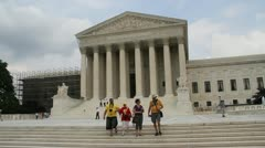 Toursits walk down the steps of the Supreme Court Stock Footage