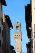 Palazzo vechio tower view in a street from florence, italy Stock Photos