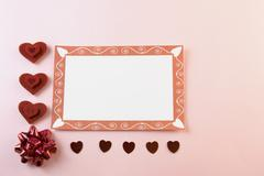 blank valentine card on pink background - stock photo
